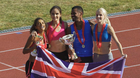 Cheerful young athletes are happy and proud about victory in championship Footage