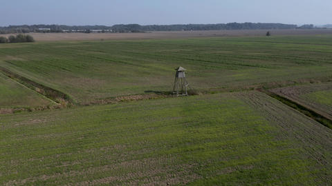 Rural landscape with fields revealing a hunting tower Live Action