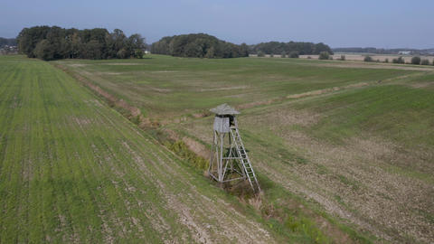 Aerial shot of hunting tower in fields Live Action