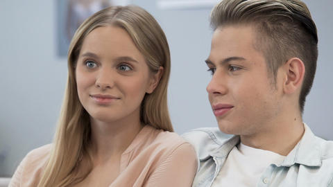 Young people looking embarrassed during first date, falling in love, happiness Live Action