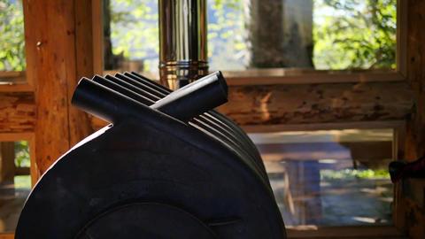 Oven buleryan indoor a wooden house. Lift the camera upwards. Background window ビデオ