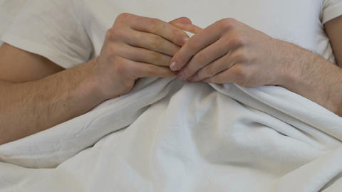 Nervous male hands blanket, sleep disorder, anxiety, prostatitis health problem Footage