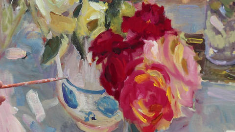 Close up of man's hand painting still life picture on canvas in art studio Footage