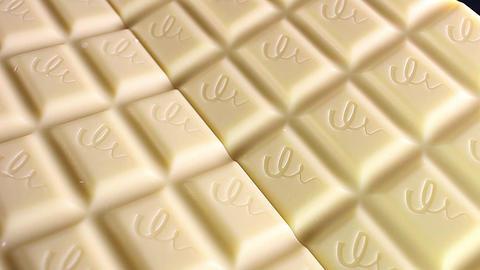 White chocolate bar bars rotating texture pattern closeup footage Footage