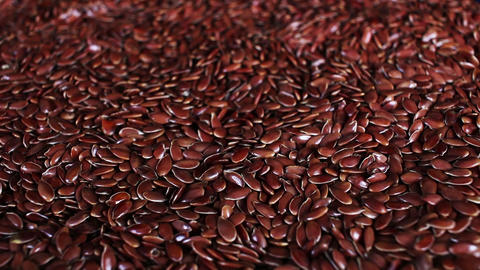 Linseed linseeds flax seed seeds rotating closeup texture pattern background Live Action