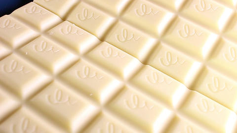 White chocolate bar bars rotating texture pattern closeup footage Live Action