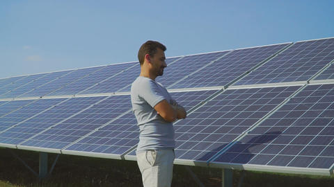 Young man shows thumb up on background of solar panels ビデオ