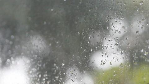 Raindrops on window rack focus Footage