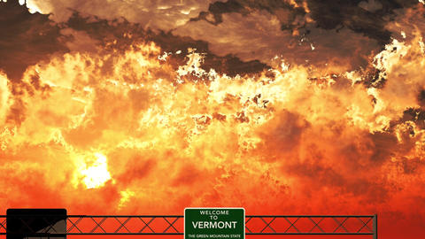 4K Passing Welcome to Vermont USA Interstate Highway Sign in the Sunset Animation