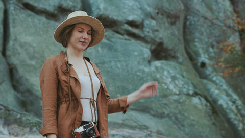 Traveler girl take a selfie portrait with rocks, lifestyle travel, slow motion Live Action