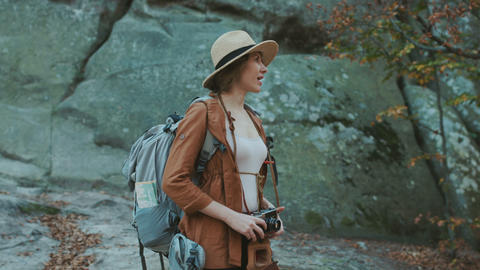 Portrait shot of beautiful young woman in hat taking... Stock Video Footage