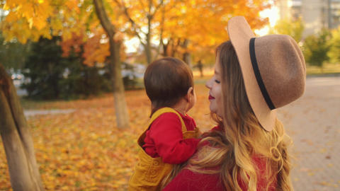 Caucasian mother mother with multiethnic daughter having fun outdoors Footage