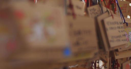Votive tablets at Asakusa shrine middle shot right tracking shot Live Action