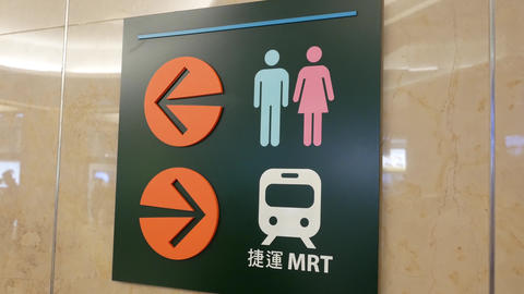 Motion of washroom logo and MRT direction sign inside shopping mall with 4k Footage