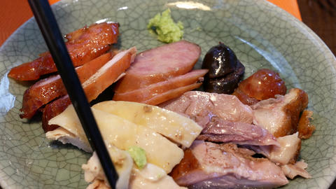 Motion of people eating chinese sausage on plate inside Chinese restaurant with Live Action