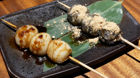 Motion of Japanese style grilled dango barbeque and sesame sauce on table inside Live Action