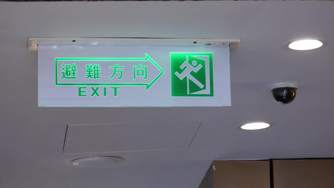Motion of security cameras and exit sign on ceiling with 4k resolution Live Action