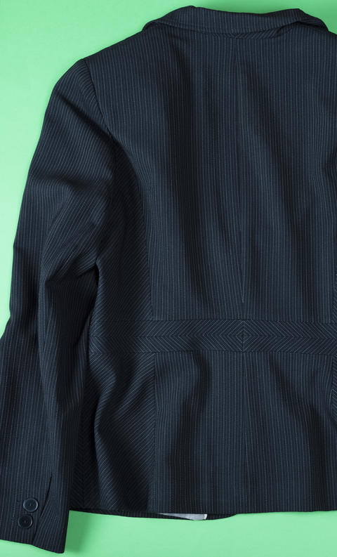 Fragment of the back of a black female jacket with stripes フォト