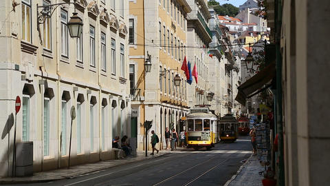 LISBON, PORTUGAL - CIRCA AUGUST 2014: Sightseeing in the city. Old trams one by Footage