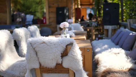 Boho interior in the cafe outdoor. Chairs covered with... Stock Video Footage