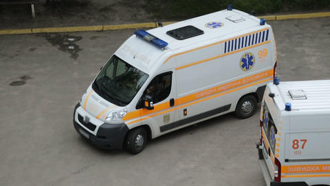 LVIV, UKRAINE - CIRCA SEPTEMBER 2017: Ambulance crew on call. Driver of new Live Action