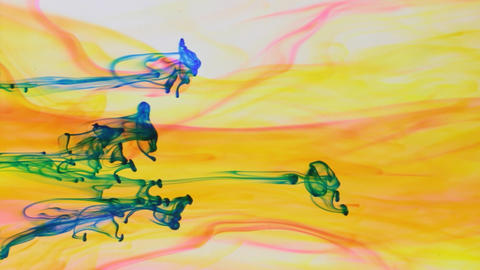 Colorful paint in dynamic flow. Blue jet of ink on yellow background Footage
