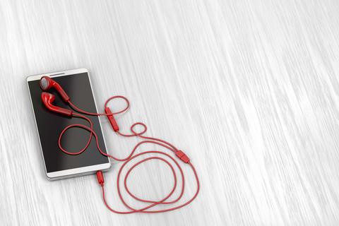 Smartphone and red earphones Photo