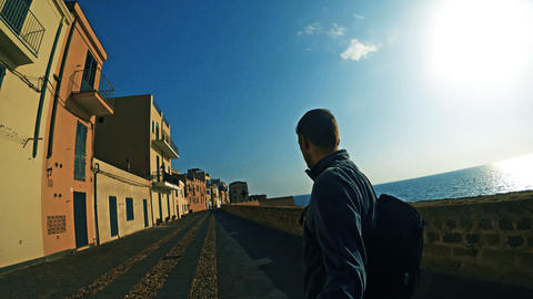 Man walking in Alghero seafront 영상물