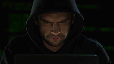 Focused man carefully working on computer, system administrator of web sites Footage