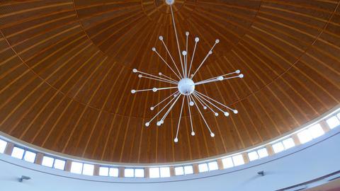 Elegant chandelier hanging in a funeral chapel Photo