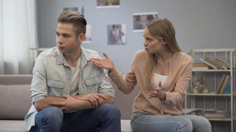 Girl chastising her boyfriend, blaming young husband, family quarrel, stress Live Action