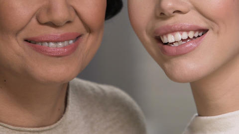 Two pretty women demonstrating perfect smile, dentistry care, health lifestyle Live Action