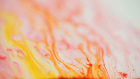 Orange and yellow paint moving upward Footage