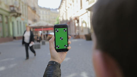 Man Taking Photo With Camera Phone In Lviv,Ukraine. Young Casual Man Taking Pict stock footage