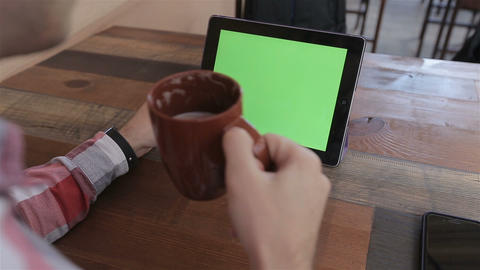 Man Using Tablet PC in Landscape Mode at Home.Tablet with Green Screen.Causal Li Footage