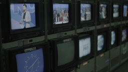 A lot of monitors with TV broadcast in the TV Studio Footage