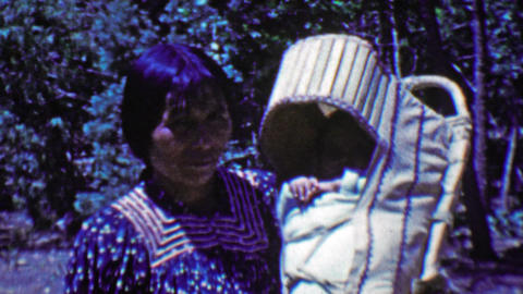 1951: Native Alaskan Inuit woman baby papoose sling carrier Footage