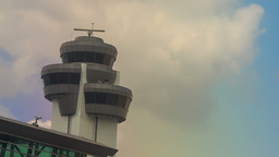 Control Tower Radar by Airport Terminal Building against Sky Footage