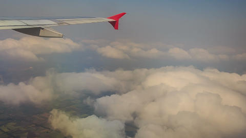 Airliner Wing Cuts White Clouds While Ascending Footage