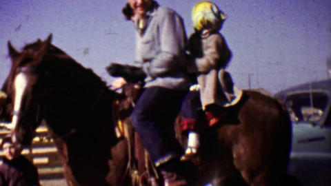 1955: Dad daughter cold weather horseback riding wave goodbye Footage