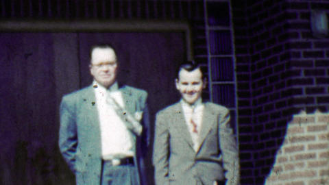 1951: Businessmen wind blows necktie dressed in expensive suits Footage