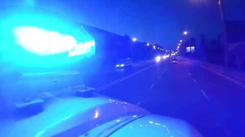 Lights of moving ambulance car flashing in twilight town, high speed necessity Live Action