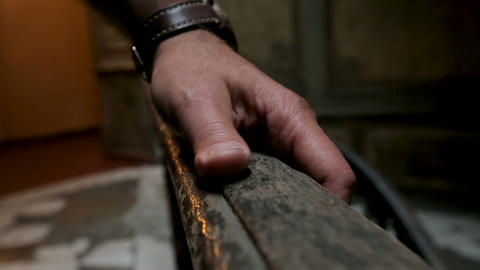 Experienced restorer assessing condition of wooden handrails at ancient building Footage