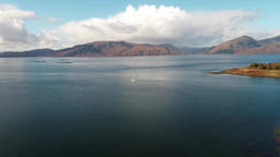 Aerial view of sailing boat in the scottish highlands close to Appin with Footage