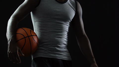 Confident team player coming to court with basket ball in hands, sportive spirit Live Action