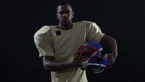 Latin team leader holding football helmet, commander spirit, main position Live Action
