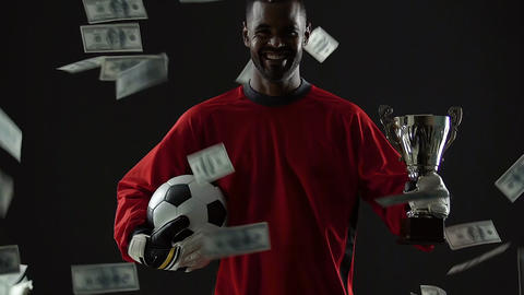 Talented sport player celebrating success, dollar bills falling down, career Footage