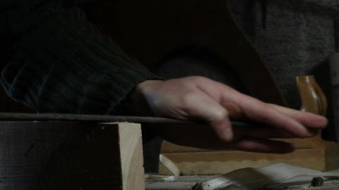 carpenter detail file a piece of wood with wood file Stock Video Footage