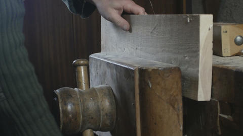 close up, carpenter squeezes a wooden board in a wooden vice Footage