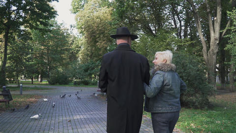 Old couple spend time at the park Footage